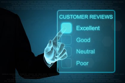 business hand clicking customer review feedback on touch screen