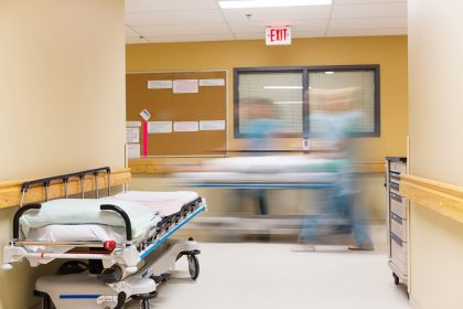 Nurses Walking In Hospital Corridor